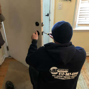 Locksmith replacing a deadbolt lock